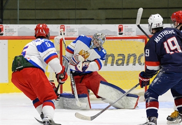 Defending champs fall to Russia