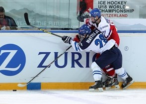 ZUG, SWITZERLAND - APRIL 16: Finland's Julius Mattila #28 and the Czech Republic's Jan Dufek #27 battle for the puck along the boards during preliminary round action at the 2015 IIHF Ice Hockey U18 World Championship. (Photo by Francois Laplante/HHOF-IIHF Images)