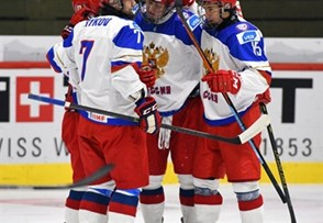 LUCERNE, SWITZERLAND - APRIL 17: Russia's Yegor Rykov #7, Danil Yurtaikin #13, Nikolai Chebykin #8 and German Rubtsov #15 celebrate after a first period goal against Germany during preliminary round action at the 2015 IIHF Ice Hockey U18 World Championship. (Photo by Matt Zambonin/HHOF-IIHF Images)