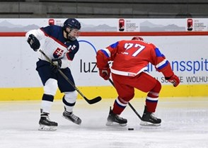 LUCERNE, SWITZERLAND - APRIL 19: Slovakia's Boris Sadecky #8 gets the puck through the skates of Russia's Dmitri Zhukenov #27 during preliminary round action at the 2015 IIHF Ice Hockey U18 World Championship. (Photo by Matt Zambonin/HHOF-IIHF Images)