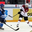 ZUG, SWITZERLAND - APRIL 19: Latvia's Rudolfs Balcers #13 lets a shot go while Finland's Vili Saarijarvi #9 defends during preliminary round action at the 2015 IIHF Ice Hockey U18 World Championship. (Photo by Francois Laplante/HHOF-IIHF Images)