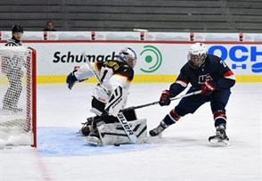 LUCERNE, SWITZERLAND - APRIL 21: USA's Christian Fischer #21 with a scoring chance against Germany's Mirko Pantkowski #1 during preliminary round action at the 2015 IIHF Ice Hockey U18 World Championship. (Photo by Matt Zambonin/HHOF-IIHF Images)