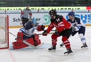 ZUG, SWITZERLAND - APRIL 21: Canada's Matt Barzal #14 with a scoring chance against Finland's Veini Vehvilainen #1 while Otto Leskinen #5 defends during preliminary round action at the 2015 IIHF Ice Hockey U18 World Championship. (Photo by Francois Laplante/HHOF-IIHF Images)