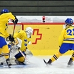 LUCERNE, SWITZERLAND - APRIL 21: Russia's Mikhail Vorobyov #10 scores a first period goal against Sweden's Daniel Marmenlind #1 while Joel Eriksson Ek #28 and Oliver Kylington #6 look on during preliminary round action at the 2015 IIHF Ice Hockey U18 World Championship. (Photo by Matt Zambonin/HHOF-IIHF Images)