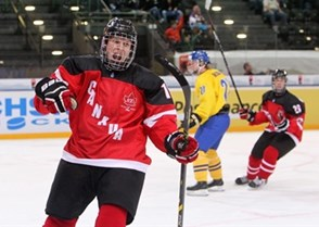 ZUG, SWITZERLAND - APRIL 23: Canada's Jansen Harkins #12 celebrates after scoring a first period goal against Sweden during quarterfinal round action at the 2015 IIHF Ice Hockey U18 World Championship. (Photo by Francois Laplante/HHOF-IIHF Images)