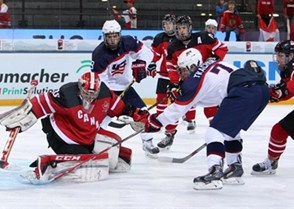 ZUG, SWITZERLAND - APRIL 25: Canada's Zach Sawchenko #30 makes the save agaisnt USA's Matthew Tkachuk #7 while Auston Matthews #19 looks on during semifinal round action at the 2015 IIHF Ice Hockey U18 World Championship. (Photo by Francois Laplante/HHOF-IIHF Images)