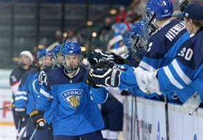 ZUG, SWITZERLAND - APRIL 26: Finland's Julius Nattinen #10 celebrate their bench during gold medal game action at the 2015 IIHF Ice Hockey U18 World Championship. (Photo by Francois Laplante/HHOF-IIHF Images)